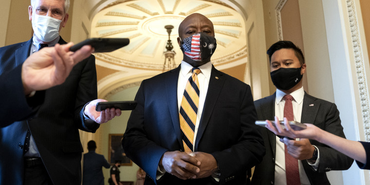 Senator Tim Scott, R-S.C., center, speaks to members of the media at the U.S. Capitol on April 21, 2021.