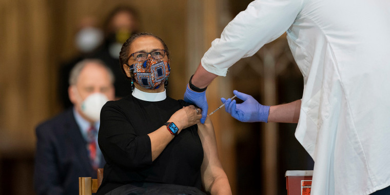 Image: Rev. Patricia Hailes Fears, pastor of the Fellowship Baptist Church in Washington, is administered with the Johnson & Johnson Covid-19 vaccine at the Washington National Cathedral