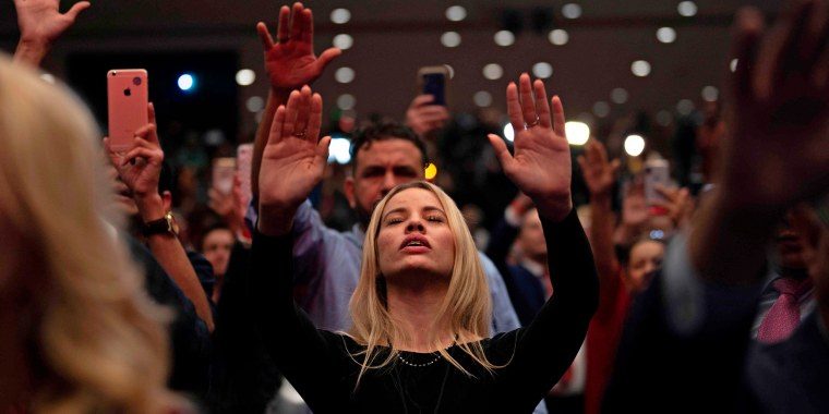 "Supporters pray as President Donald Trump speaks during a ""Evangelicals for Trump\"" campaign event held at the King Jesus International Ministry on Jan. 3, 2020 in Miami."