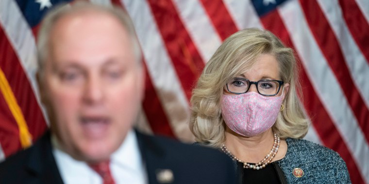 Rep. Liz Cheney, R-Wyo., listens as Rep. Steve Scalise, R-La., speaks on Capitol Hill on April 20, 2021.