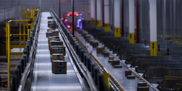 Image: Orders move down a conveyor belt at an Amazon fulfillment center in Staten Island, N.Y.