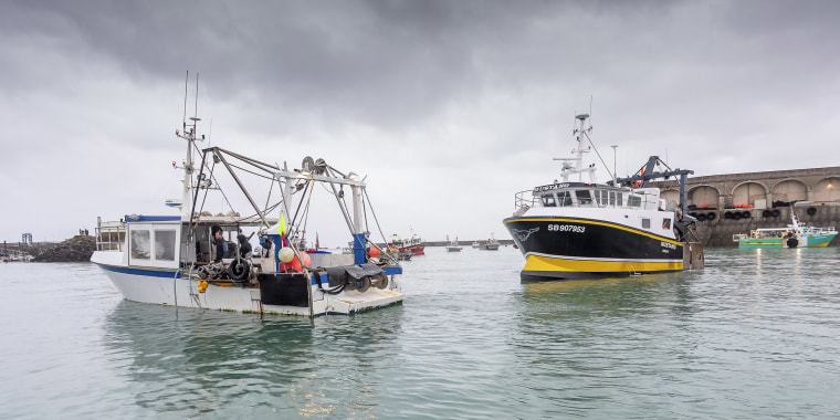 Image: French fishing vessels block the port of St Helier in Jersey