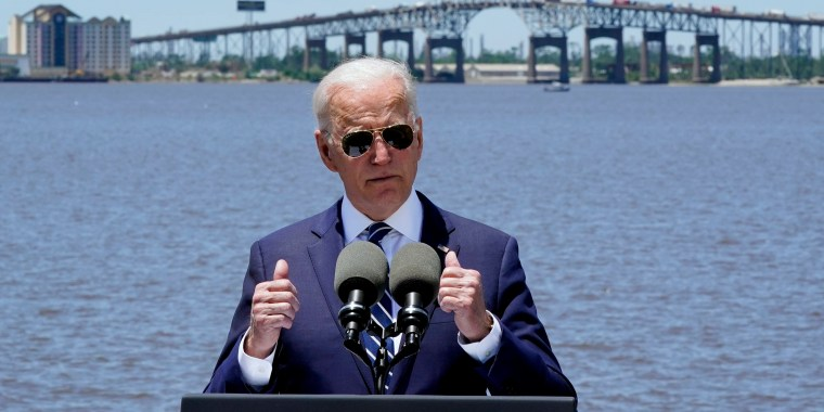 Image: President Joe Biden speaks with the Interstate 10 Calcasieu River Bridge behind him on May 6, 2021, in Lake Charles, La.