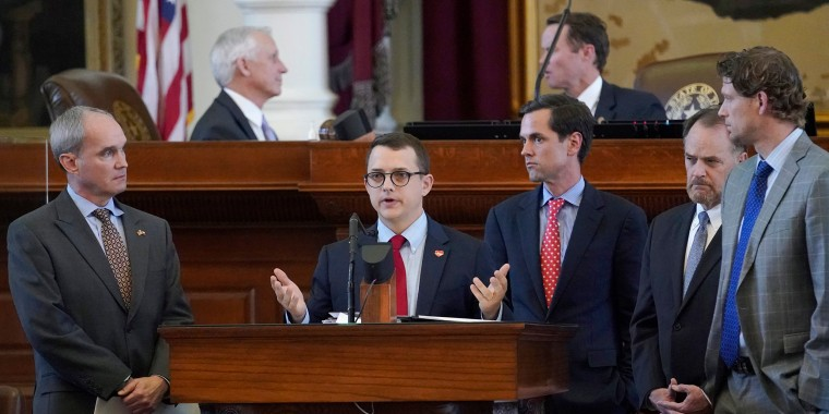 Image: Rep. Briscoe Cain, R-Houston, center, speaks in favor of HB 6, an election bill, in the House Chamber at the Texas Capitol in Austin, Tx.