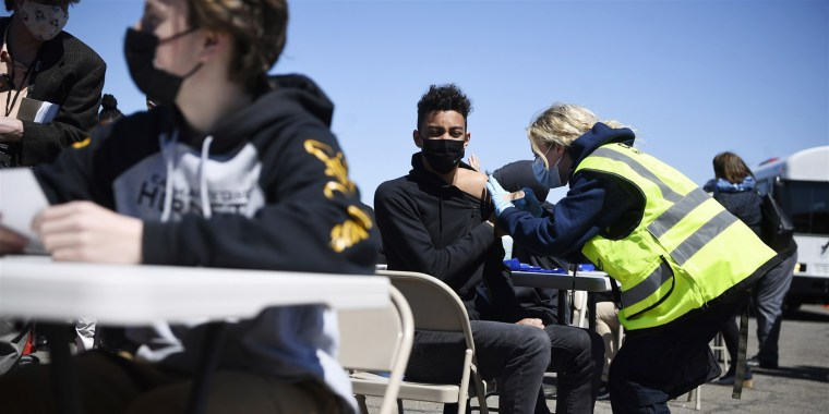 East Hartford High School students receive a vaccination at Pratt & Whitney Runway in East Hartford, Conn., Monday, April 26, 2021.