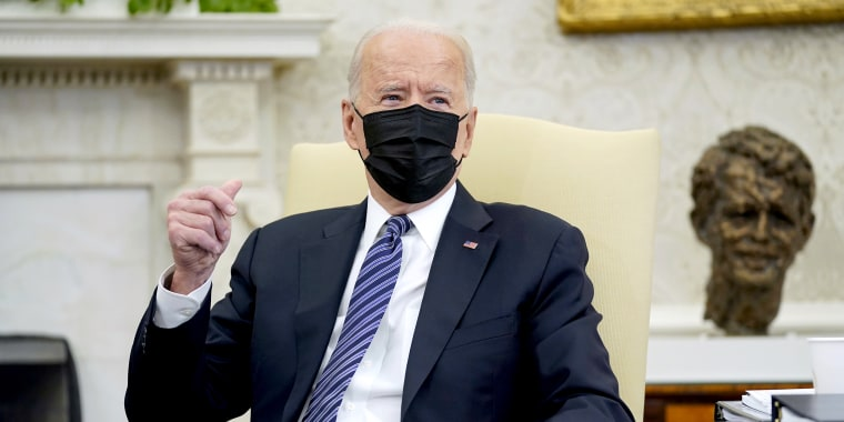 Image: President Joe Biden snaps his fingers as he responds to a reporters question during a meeting with congressional leaders in the Oval Office of the White House on May 12, 2021.