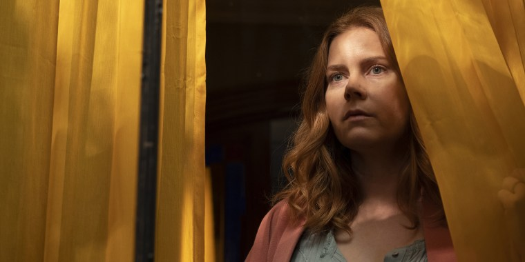 """Image:; Amy Adams as Anna Fox in \""""Woman in the Window.\"""""""
