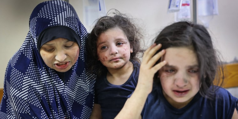 A Palestinian family arrives at Al-Shifa hospital after intensive Israeli bombardments on Gaza City on May 16, 2021.