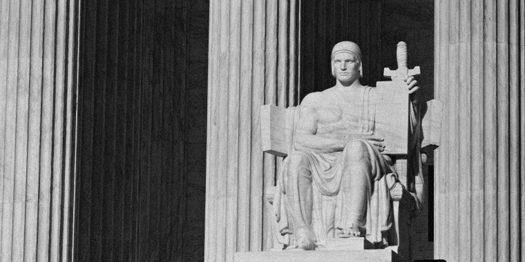 "Image: The ""Authority of Law\"" statue sits at the U.S. Supreme Court building"