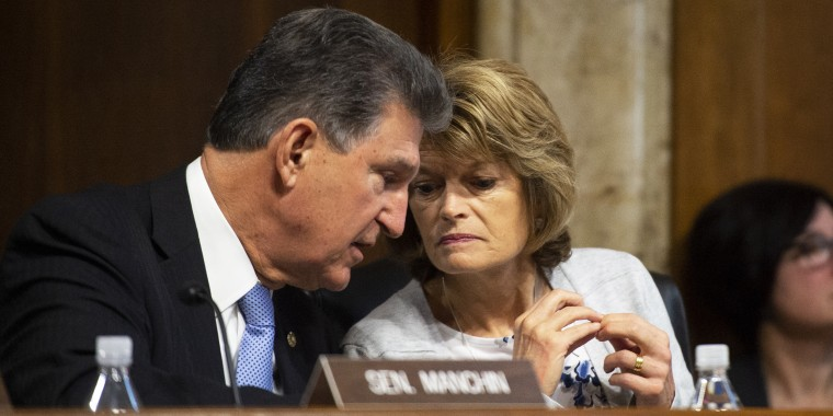 Sen. Joe Manchin, D-W. Va., speaks to Sen. Lisa Murkowski, R-Alaska, during a Senate hearing on March 10, 2020.