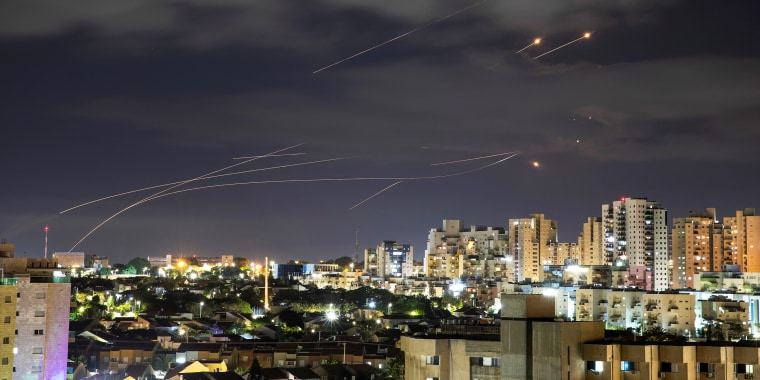 Image: Streaks of light are seen as Israel's Iron Dome anti-missile system intercepts rockets launched from the Gaza Strip towards Israel, as seen from Ashkelon, Israel