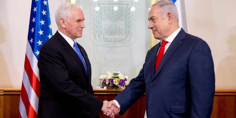 Image: Vice President Mike Pence shakes hands with Israeli Prime Minister Benjamin Netanyahu during their meeting at the Prime Minister's Office in Jerusalem