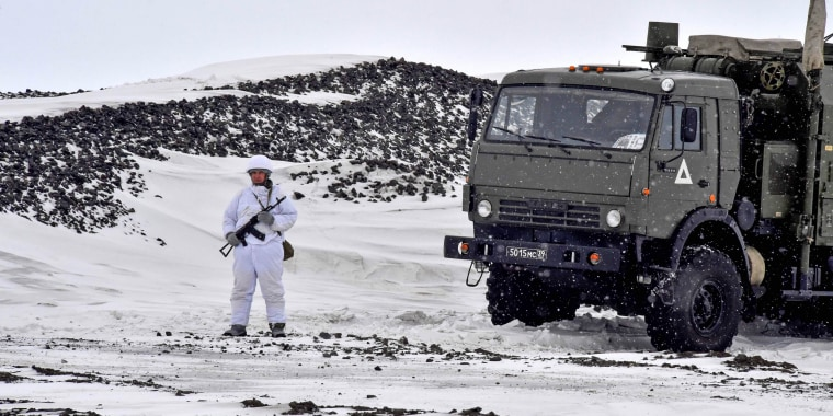 A Russian serviceman stands guard by a military truck on the island of Alexandra Land, part of the Franz Josef Land archipelago, on May 17.