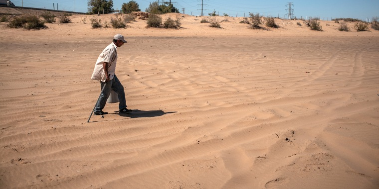 Image: A Cucapa man walking near the desert border between Mexico and the United States, in Baja California, April 2021.