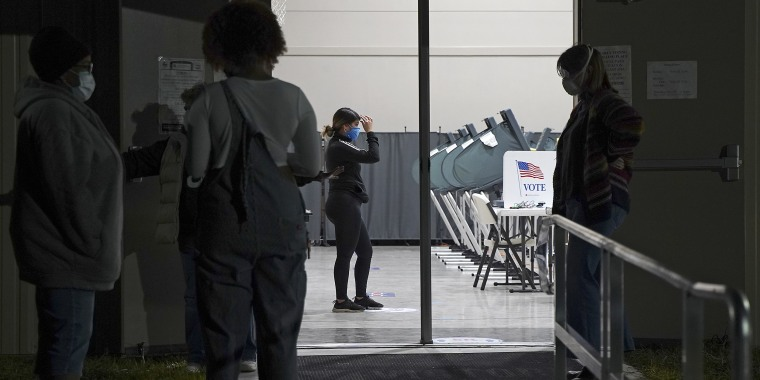 Image: Voters wait to cast their ballots at a 24-hour polling station in Houston Oct. 30, 2020.