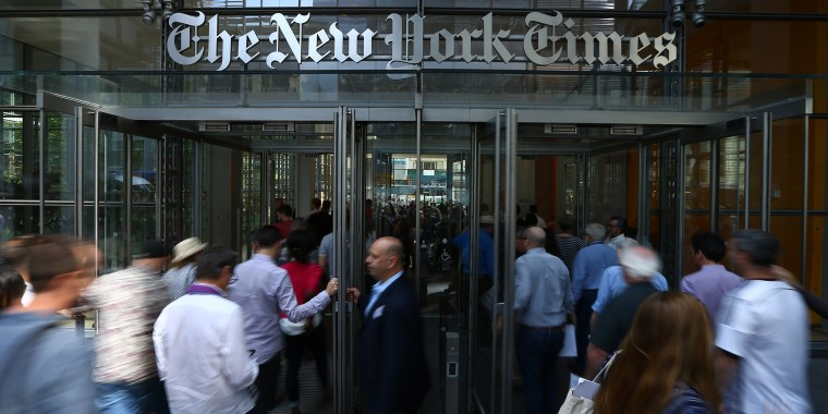 Image: People enter The New York Times building on June 29, 2017.