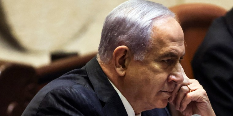 Israeli Prime Minister Benjamin Netanyahu delivers a speech during a special session of the Knesset to approve and swear-in a new coalition government in Jerusalem on June 13, 2021.