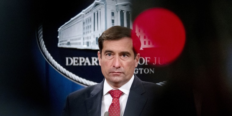 Image: John Demers listens to a question during a news conference at the Department of Justice on Oct. 19, 2020.