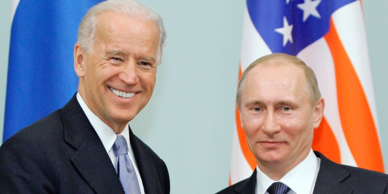 Image: Then Vice President  Joe Biden, left, shakes hands with Russian Prime Minister Vladimir Putin in Moscow, Russia