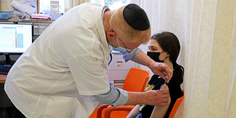 Image: A young teen receives a dose of the Pfizer/BioNTech Covid-19 vaccine at the Misgav Ladach hospital in Jerusalem on June 6, 2021, as Israel begins coronavirus vaccination campaign for 12 to 15-year-olds.