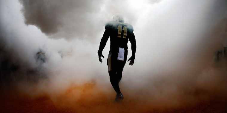 Image: Taylor Young #11 of the Baylor Bears walks on the field before taking on the TCU Horned Frogs at McLane Stadium in Waco, Texas, on Oct. 11, 2014.