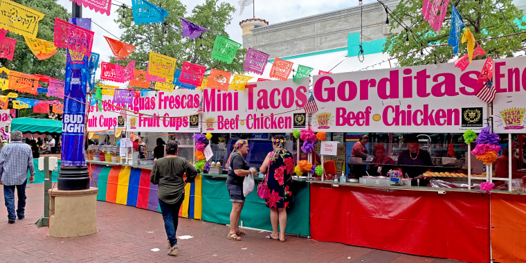 Some of the food that is a big part of San Antonio's annual celebration was being served in the partially returned and delayed event held in the city's downtown.
