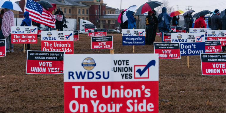 Pro-union demonstration signs stand outside the Amazon Fulfillment Center in Bessemer, Ala., on Feb. 7, 2021.
