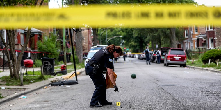 Judge: An officer collects evidence at the scene where an 8-year-old girl was shot on the 1000 block of North Monticello Avenue on Aug. 11, 2019 in Chicago.
