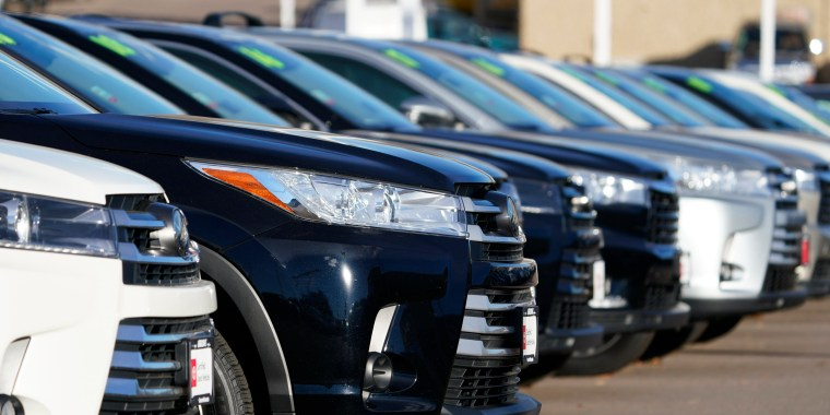 A long row of unsold used Highlander sports-utility vehicles sits at a Toyota dealership in Englewood, Colo., on Nov. 15, 2020.