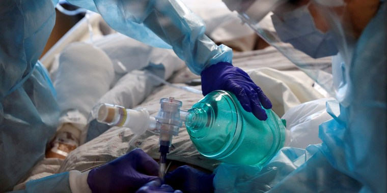 Image: Critical care workers insert an endotracheal tube into a coronavirus disease (COVID-19) positive patient in the intensive care unit (ICU) at Sarasota Memorial Hospital in Sarasota, Florida