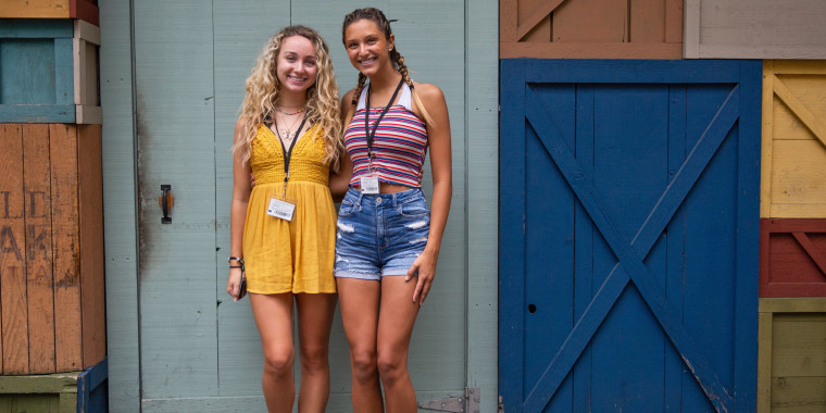 Image: Rachel Nelson, 18, left, and Emma Short, 18, best friends and incoming freshman at the University of Tennessee Knoxville pose for a photo at Dollywood in Pigeon Forge, Tenn.