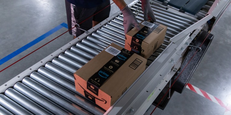 Image: Boxes move along a conveyor belt at an Amazon fulfillment center on Prime Day in Raleigh, N.C.