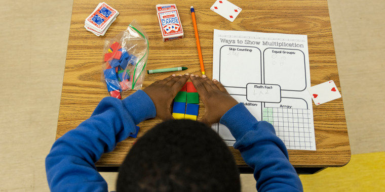 A student uses tiles while working on a multiplication problem at Ida Green Elementary.