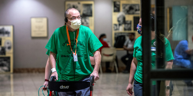 Medivac pilot Ricky Hamm leaves University of Alabama Hospital, where he stayed for 187 days battling Covid-19.