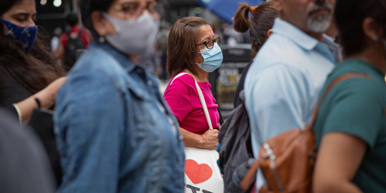 A woman wears a mask in midtown New York on July 29 2021.