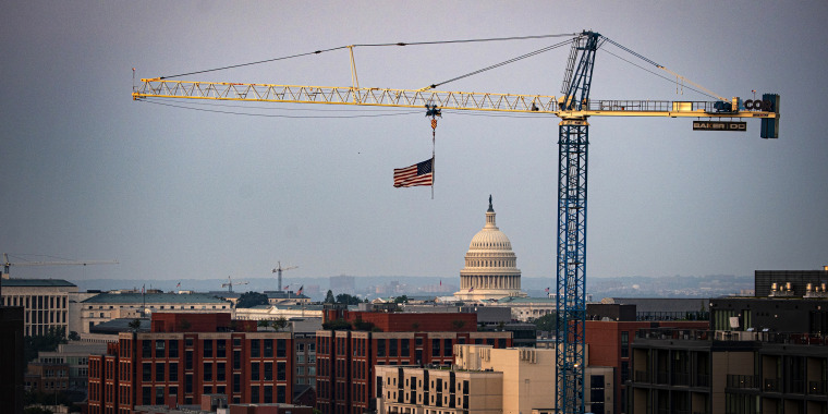 A construction crane in front of the U.S. Capitol on Aug. 2, 2021.