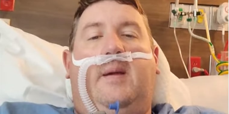 Image: Travis Campbell has been making Facebook videos and posts asking people to get vaccinated against Covid-19 after testing positive and being hospitalized for the virus.