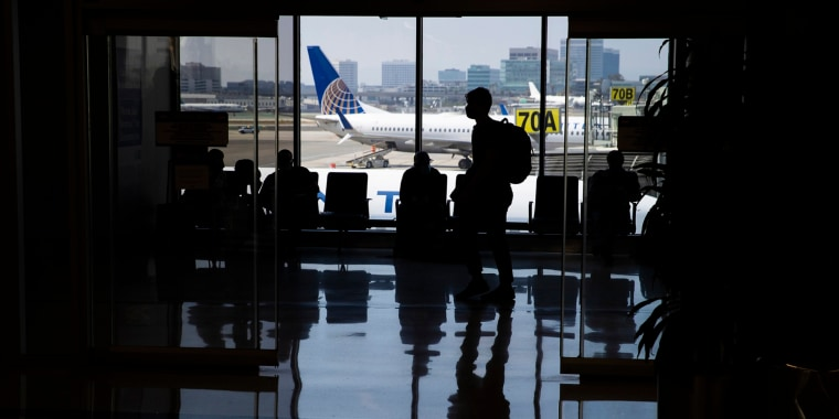 Travelers wait for their departures at Los Angeles International Airport on May 28, 2021.