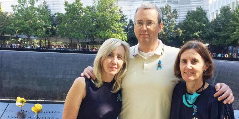 Image: Glenn Morgan with his sisters Colleen Golden, left, and Cathy Morgan at the 9/11 memorial in New York City.