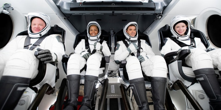 The Inspiration4 crew of Chris Sembroski, Sian Proctor, Jared Isaacman and Hayley Arceneaux sits while suited up on Sept. 15, 2021.
