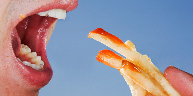 Close-up of someone eating french fries