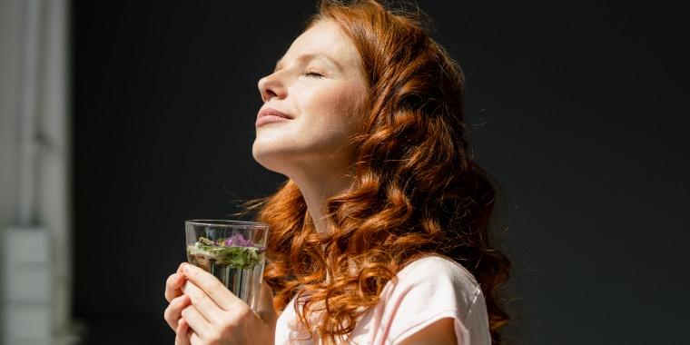 Redheaded woman enjoying sunlight