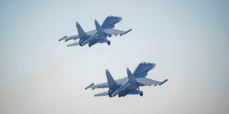 Two Chinese J-16 air fighters take off at a training base of PLA's naval aviation force in Ningbo in east China's Zhejiang province on Jan. 14, 2021.