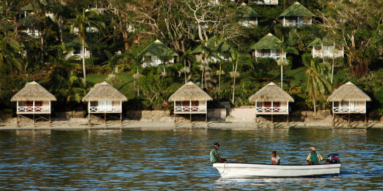 Image: FILE PHOTO: People commute on boats to Port Vila, capital city of the Pacific island nation of Vanuatu