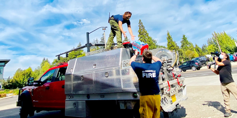 A team of McMinnville Firefighters, led by Suzy Burkhert, load an engine with gear to deploy to on a wildfire in Oregon.