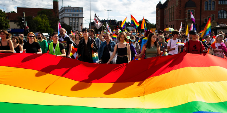 """People march in the \""""Equality Parade\"""" in Gdansk, Poland, on Aug. 21, 2021."""