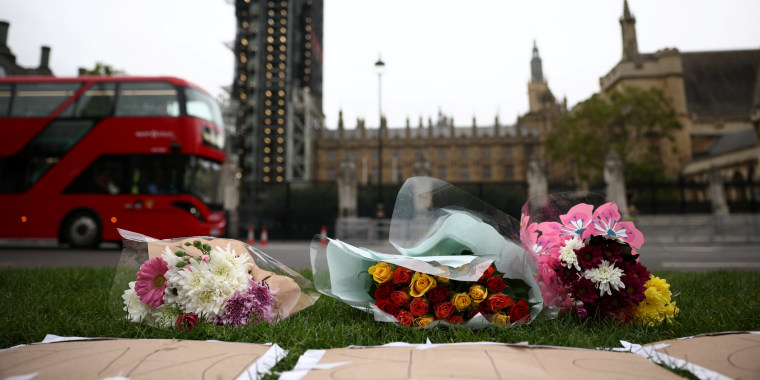 Image: Floral tributes to killed British MP Amess outside parliament in London
