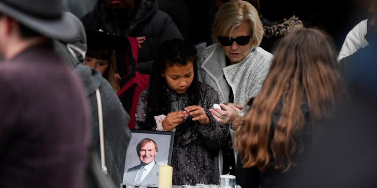 Image: People hold candles as they attend a vigil for MP David Amess, who was stabbed to death during a meeting with constituents, at Civic Centre in Southend-on-Sea, Great Britain, on Oct. 16, 2021.