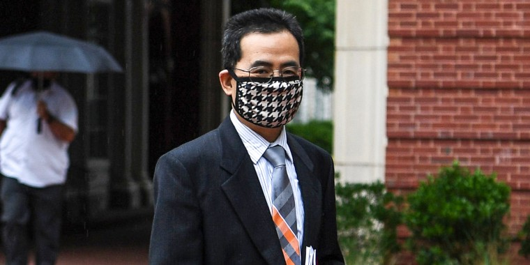 Anming Hu enters the Howard H. Baker Jr. United States Courthouse in downtown Knoxville, Tenn., on June 7, 2021.