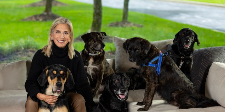 Cathy Bissell, founder of BISSELL Pet Foundation, with her adopted rescue dogs Roxy, Taz, Mo, Zoey, Hank and Lexi.